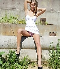 Girl plays with dress showing upskirt