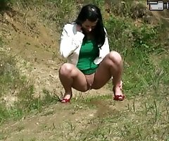 Girl on high heels gets busted pissing in forest